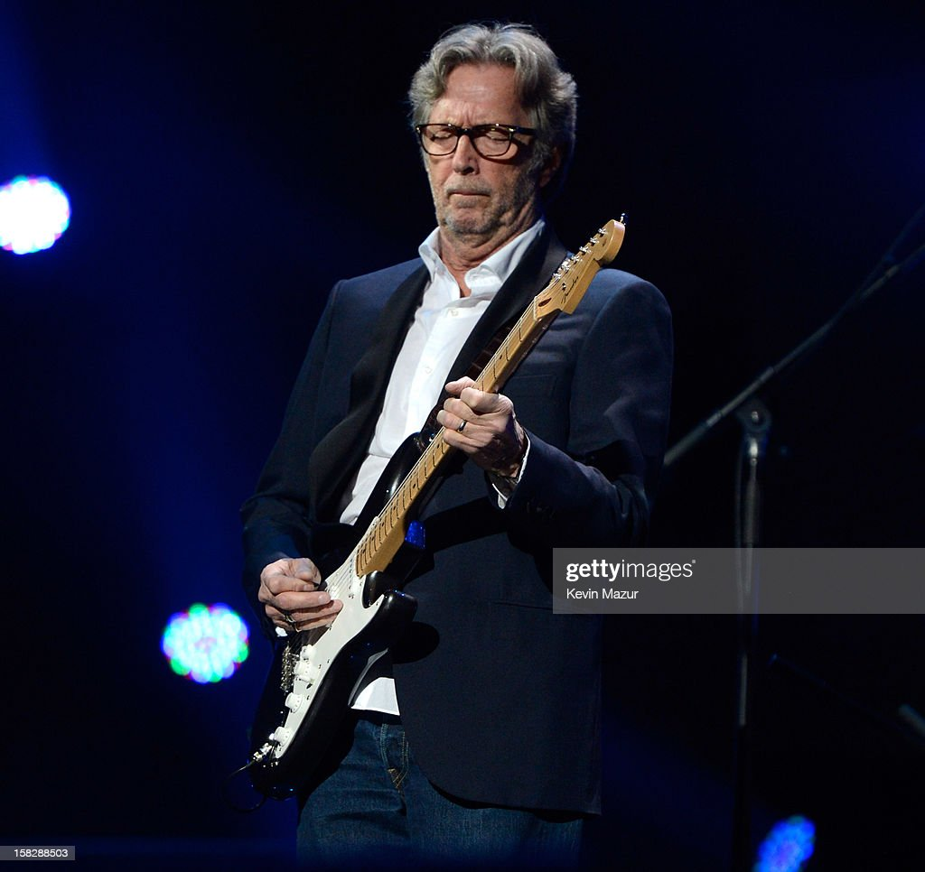 Eric Clapton performs at '12-12-12' a concert benefiting The Robin Hood Relief Fund to aid the victims of Hurricane Sandy presented by Clear Channel Media & Entertainment, The Madison Square Garden Company and The Weinstein Company at Madison Square Garden on December 12, 2012 in New York City.