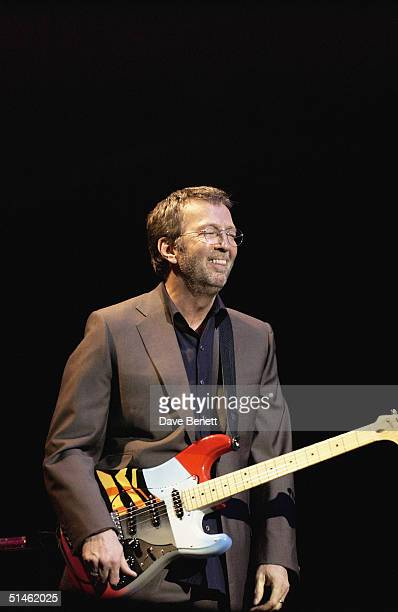 Eric Clapton performs at the ' One Generation 4 Another' concert in aid of the Lord Taverners Charity at The Royal Albert Hall on March 16 2004 in...