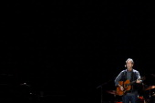 Eric Clapton performs during his Crossroads Guitar Festival at US Airways Center on March 14 2013 in Phoenix Arizona
