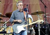 Eric Clapton performs during the 2014 New Orleans Jazz Heritage Festival Day 3 at Fair Grounds Race Course on April 27 2014 in New Orleans Louisiana