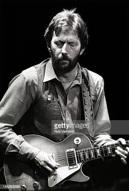 Eric Clapton performs on stage at Ahoy Rotterdam Netherlands 23rd April 1983 He plays a Gibson Les Paul Standard guitar