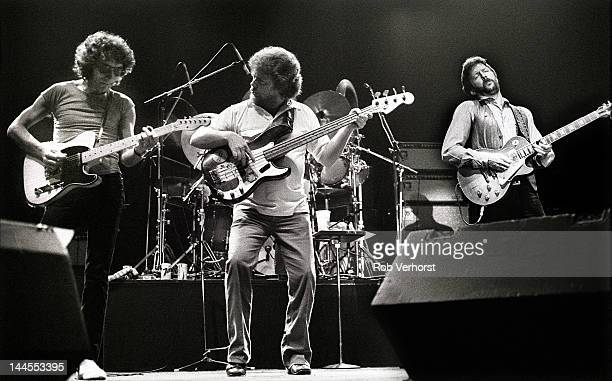 Eric Clapton performs on stage at Ahoy Rotterdam Netherlands 23rd April 1983 Left to right Albert Lee Donald 'Duck' Dunn and Eric Clapton