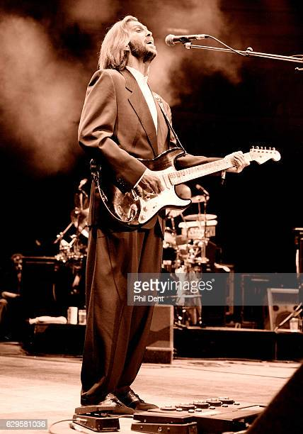Eric Clapton performs on stage at the Royal Albert Hall London 1991 He has a multieffects pedal board and wah wah pedal at his feet