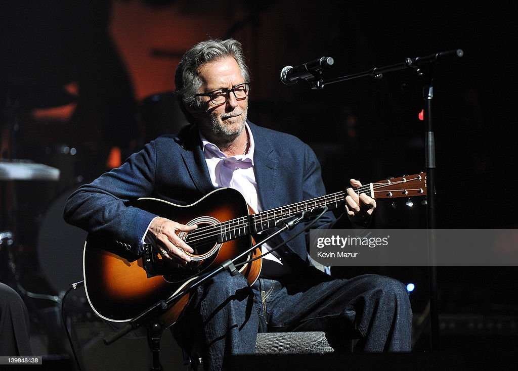 Eric Clapton performs on stage during Howlin For Hubert: A Concert to Benefit the Jazz Foundation of America at The Apollo Theater on February 24, 2012 in New York City.