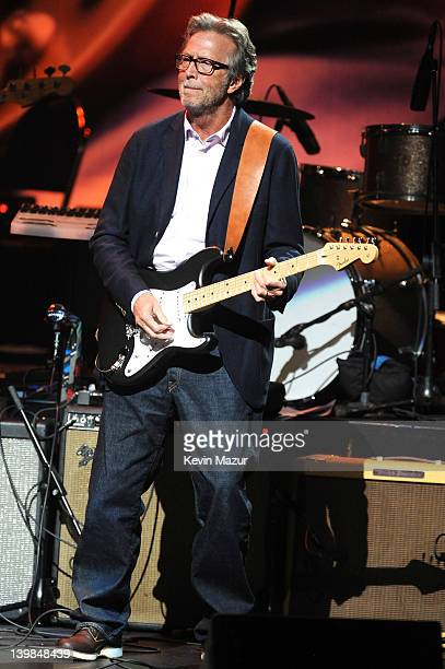 Eric Clapton performs on stage during Howlin For Hubert A Concert to Benefit the Jazz Foundation of America at The Apollo Theater on February 24 2012...