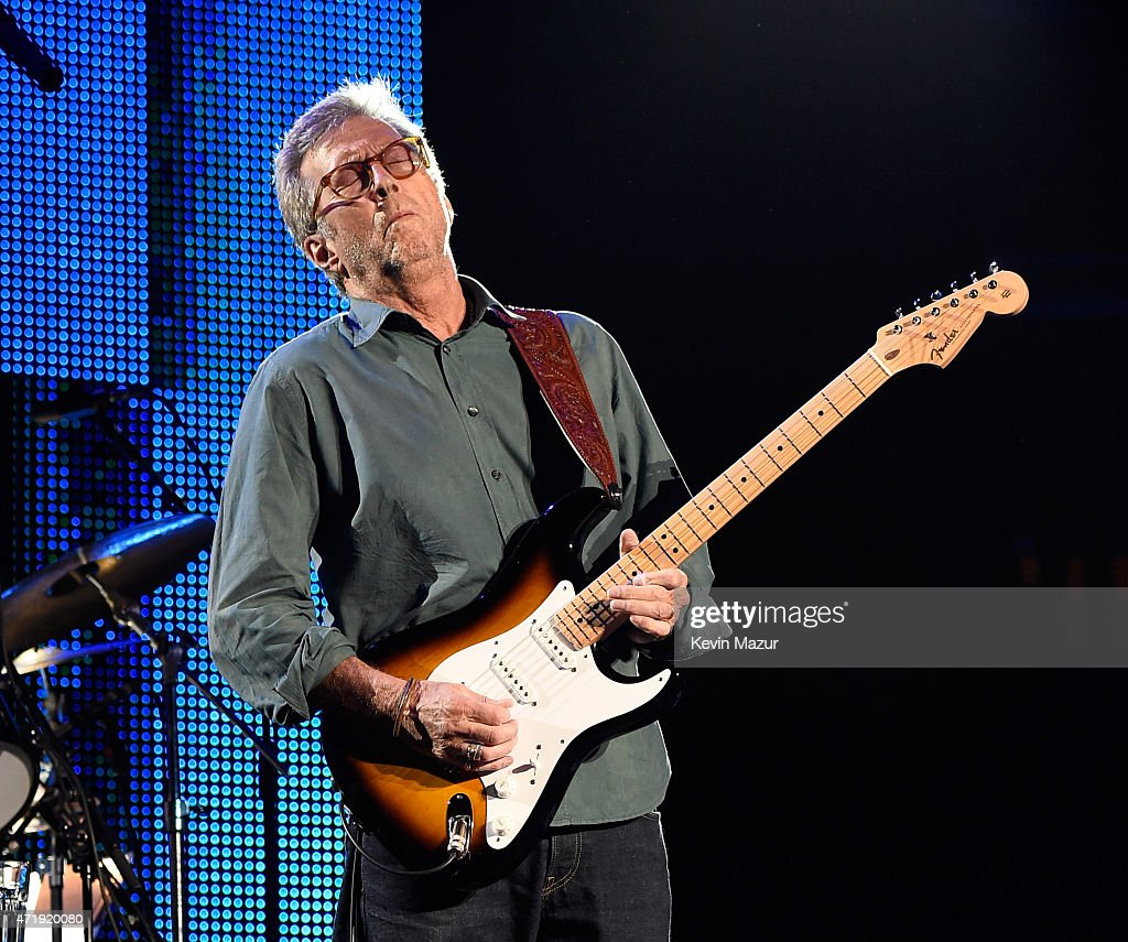 Eric Clapton performs onstage during his 70th Birthday Concert ...