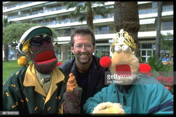 Eric Clapton poses with the puppets Zig and Zag from the UK Channel 4 morning show The Big Breakfast
