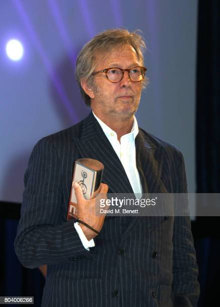 Eric Clapton presents the American Express Icon Award at the Nordoff Robbins O2 Silver Clef Awards at The Grosvenor House Hotel on June 30 2017 in...