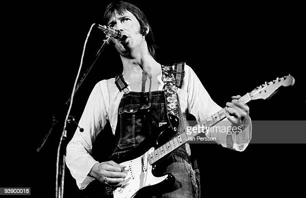 Eric Clapton wearing dunagrees performs on stage at KB Hallen on June 20th 1974 in Copenhagen Denmark He plays his Fender Stratocaster guitar...