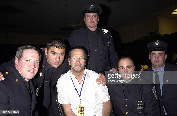 Eric Clapton with members of the New York Fire Department
