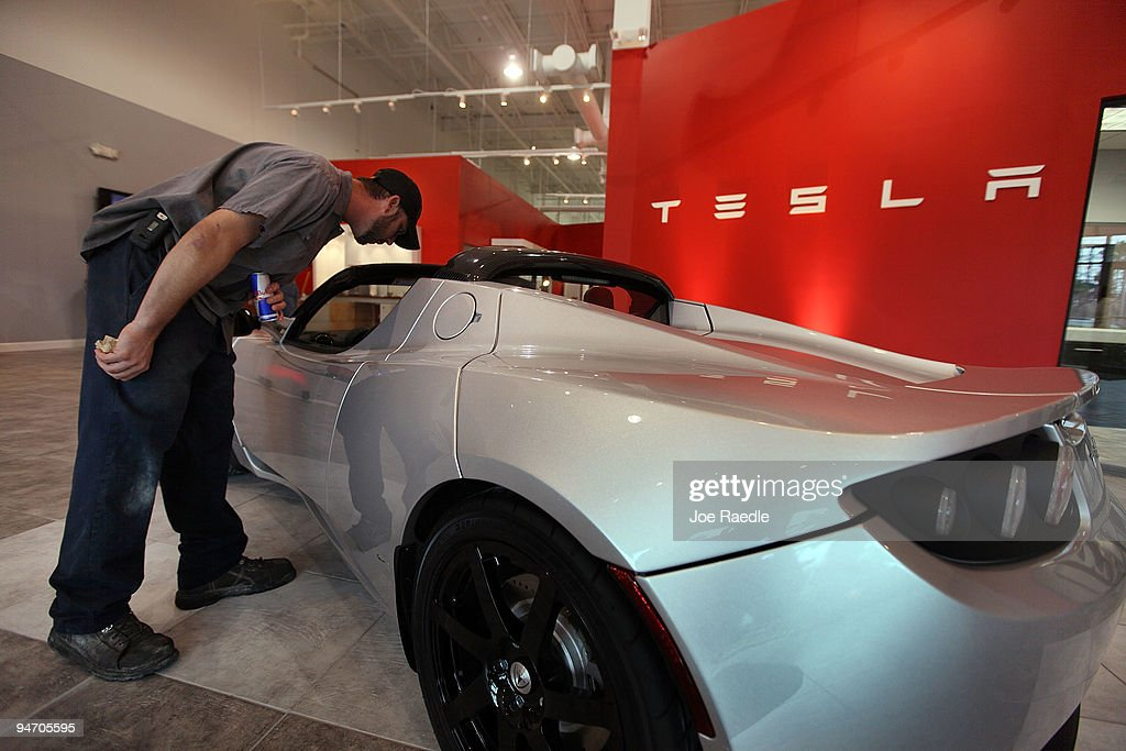 Eric Clark checks out a Roadster Sport on the floor of the Tesla Motors first South Florida location on December 17, 2009 in Dania Beach, Florida. Tesla produces high-performance electric vehicles with a fully electric power train.