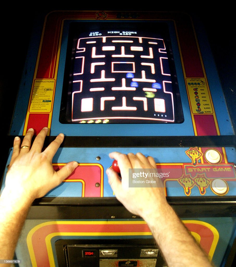 Eric Clayberg plays 'Ms PacMan' that is part of his impressive collection of '80s video arcade games in his basement It is possibly the largest...