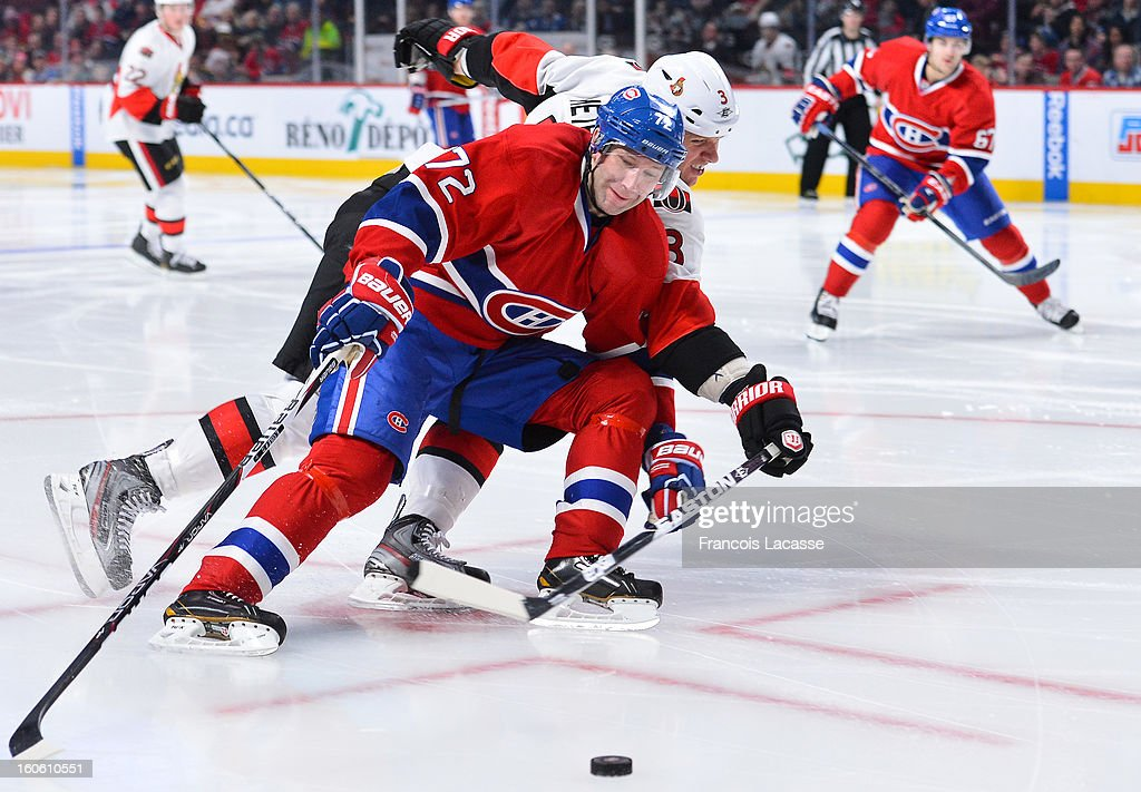 Eric Cole #72 of the Montreal Canadiens battles for the puck with <a gi-track='captionPersonalityLinkClicked' href=/galleries/search?phrase=Marc+Methot&family=editorial&specificpeople=2216900 ng-click='$event.stopPropagation()'>Marc Methot</a> #3 of the Ottawa Senators during the NHL game on February 3, 2013 at the Bell Centre in Montreal, Quebec, Canada.