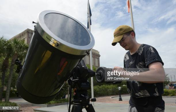 Eric Colley sets up his telescope in Charleston South Carolina on the day of the total solar eclipse on August 21 2017 The Sun started to vanish...