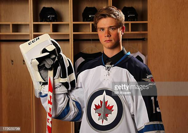 Eric Comrie 59th pick overall by the Winnipeg Jets poses for a portrait during the 2013 NHL Draft at Prudential Center on June 30 2013 in Newark New...