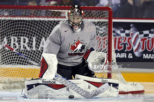Eric Comrie makes a save during the Canada National Junior Team practice at the Meridian Centre on December 17 2014 in St Catharines Ontario Canada