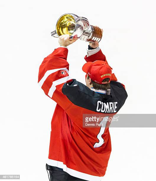 Eric Comrie of Canada celebrates with the trophy after a 54 win against Russia during the Gold medal game of the 2015 IIHF World Junior Championship...