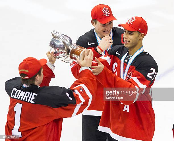 Eric Comrie of Canada passes the trophy to teammate Darnell Nurse after a 54 win against Russia during the Gold medal game of the 2015 IIHF World...
