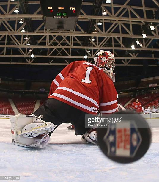 Eric Comrie of Team Canada gives up a goal in the first minute of play against Team Finland during the 2013 USA Hockey Junior Evaluation Camp at the...