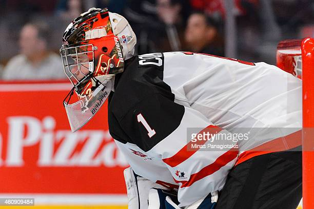 Eric Comrie of Team Canada looks on during the 2015 IIHF World Junior Hockey Championship game against Team Germany at the Bell Centre on December 27...