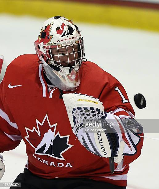 Eric Comrie of Team Canada skates against Team Finland during the 2013 USA Hockey Junior Evaluation Camp at the Lake Placid Olympic Center on August...