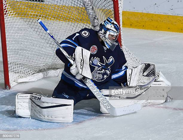 Eric Comrie of the Manitoba Moose stops a shot against the Toronto Marlies during AHL game action on December 5 2015 at the Ricoh Coliseum in Toronto...