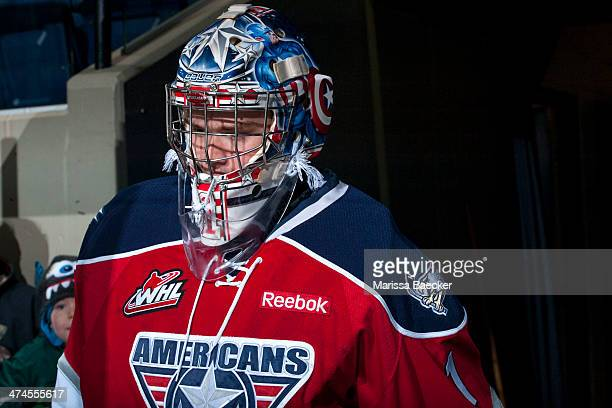 Eric Comrie of the Tri City Americans walks to the bench against the Kelowna Rockets on February 19 2014 at Prospera Place in Kelowna British...