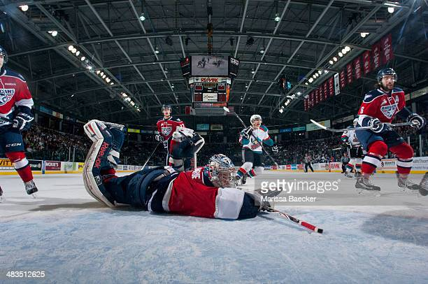 Eric Comrie of the TriCity Americans allows a goal from the Kelowna Rockets on March 22 2014 during game 1 of the first round of WHL Playoffs at...