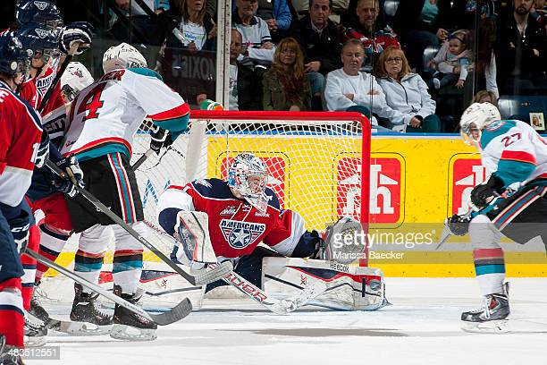 Eric Comrie of the TriCity Americans makes a save against the Kelowna Rockets on March 23 2014 during game 2 of the first round of WHL Playoffs at...