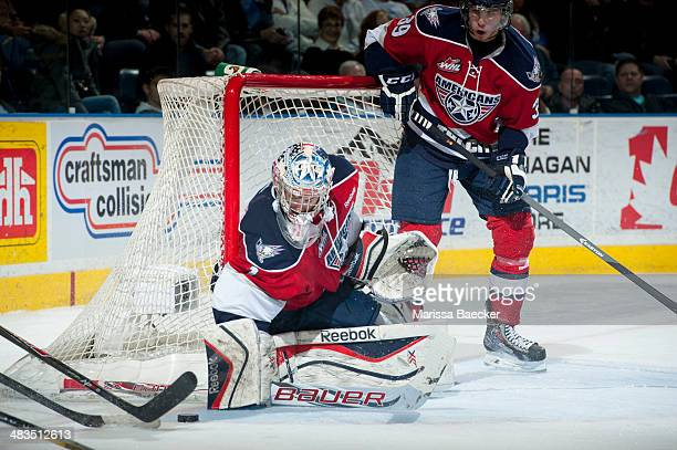 Eric Comrie of the TriCity Americans makes a save against the Kelowna Rockets on March 22 2014 during game 1 of the first round of WHL Playoffs at...