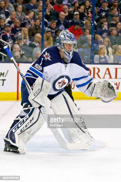 Eric Comrie of the Winnipeg Jets lines up for a faceoff while making his NHL debut during the game against the Columbus Blue Jackets on April 6 2017...