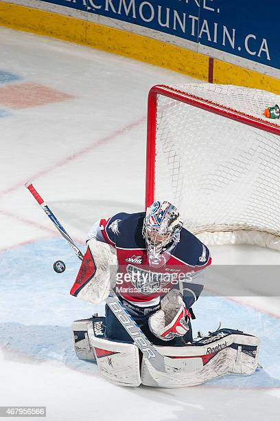 Eric Comrie of TriCity Americans makes a save against the Kelowna Rockets on March 27 2015 at Prospera Place in Kelowna British Columbia Canada
