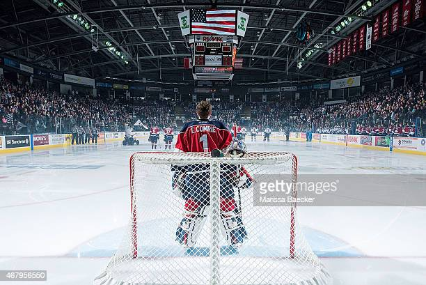 Eric Comrie of TriCity Americans stands in net during the national anthem of the first game of round 1 playoffs against the Kelowna Rockets on March...