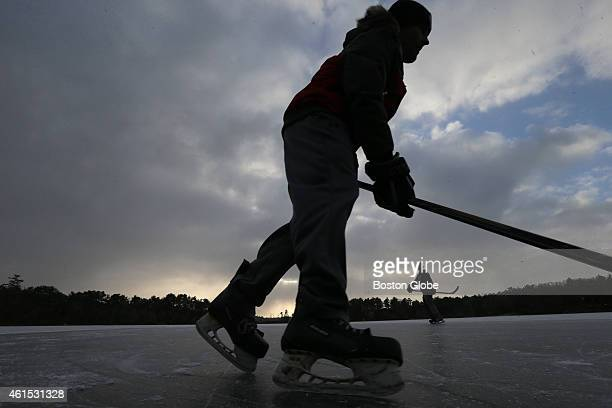 Eric Covell and Drew Canavan both of Plymouth Mass enjoy the ice at what the locals call 'Legion Pond' in Plymouth Mass for a little pond hockey