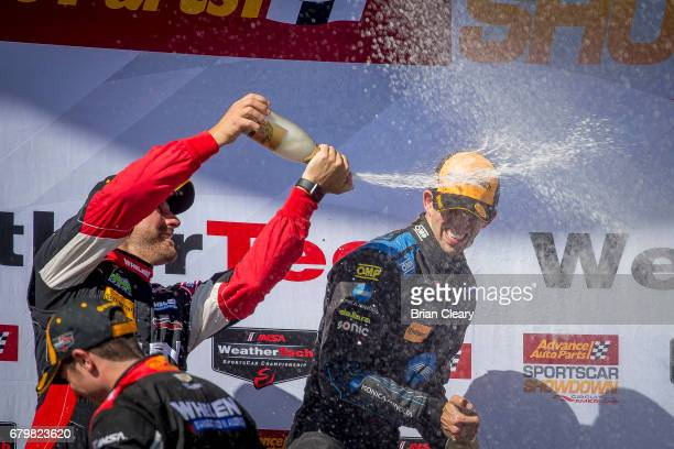 Eric Curran L sprays Ricky Taylor with champagne in victory lane after the Advance Auto Parts Sportscar Showdown at Circuit of The Americas on May 6...