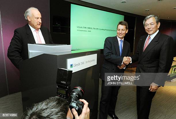 Eric Daniels Chief Executive of Lloyds TSB shakes hands with Andy Hornby Chief Executive Officer of Halifax Bank of Scotland as Lloyds TSB Chairman...