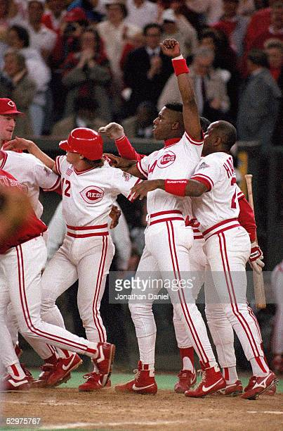 Eric Davis of the Cincinnati Reds celebrates with teammates at the end of Game two of the 1990 World Series against the Oakland Athletics at...