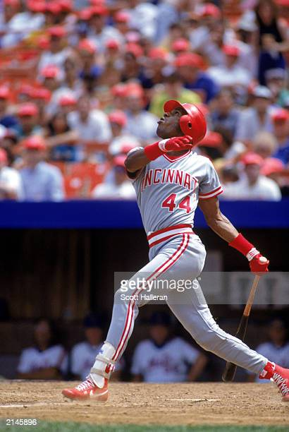 Eric Davis of the Cincinnati Reds follows the ball after his swing during a MLB game in the 1990 season