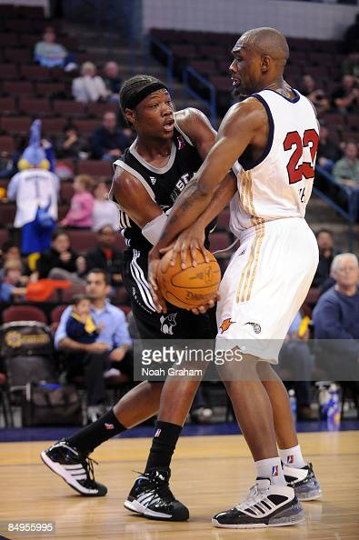 Eric Dawson of the Austin Toros looks to pass against Justin Reed of the Bakersfield Jam in a NBAD League Game at the Rabobank Arena on February 19...