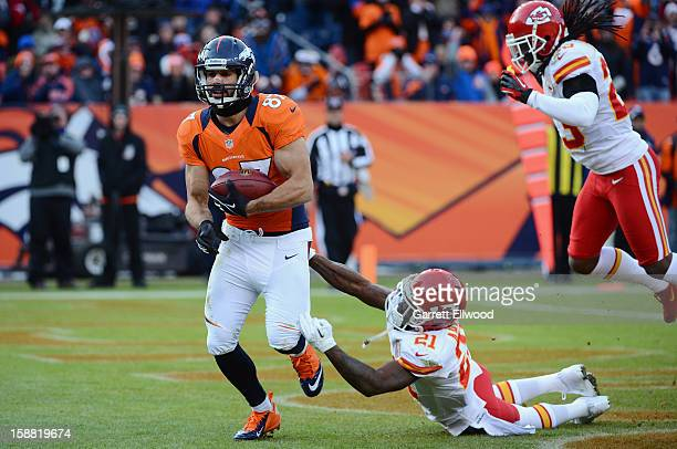 Eric Decker of the Denver Broncos catches a touchdown pass during the game against the Kansas City Chiefs at Sports Authority Field at Mile High on...