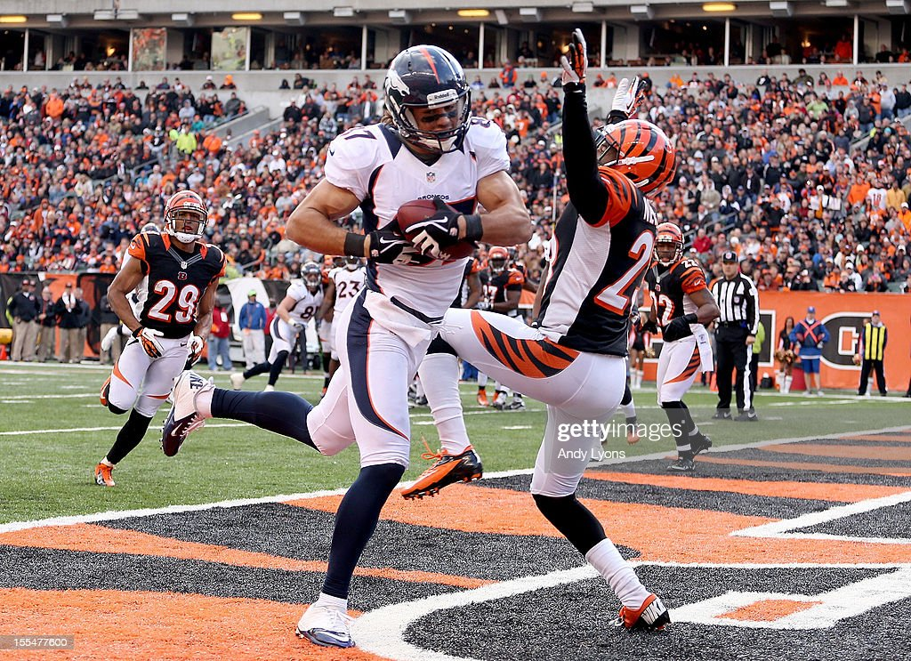 <a gi-track='captionPersonalityLinkClicked' href=/galleries/search?phrase=Eric+Decker&family=editorial&specificpeople=3950667 ng-click='$event.stopPropagation()'>Eric Decker</a> #87 of the Denver Broncos catches a touchdown pass while defended by <a gi-track='captionPersonalityLinkClicked' href=/galleries/search?phrase=Terence+Newman&family=editorial&specificpeople=220965 ng-click='$event.stopPropagation()'>Terence Newman</a> #23 of the Cincinnati Bengals during the NFL game at Paul Brown Stadium on November 4, 2012 in Cincinnati, Ohio.