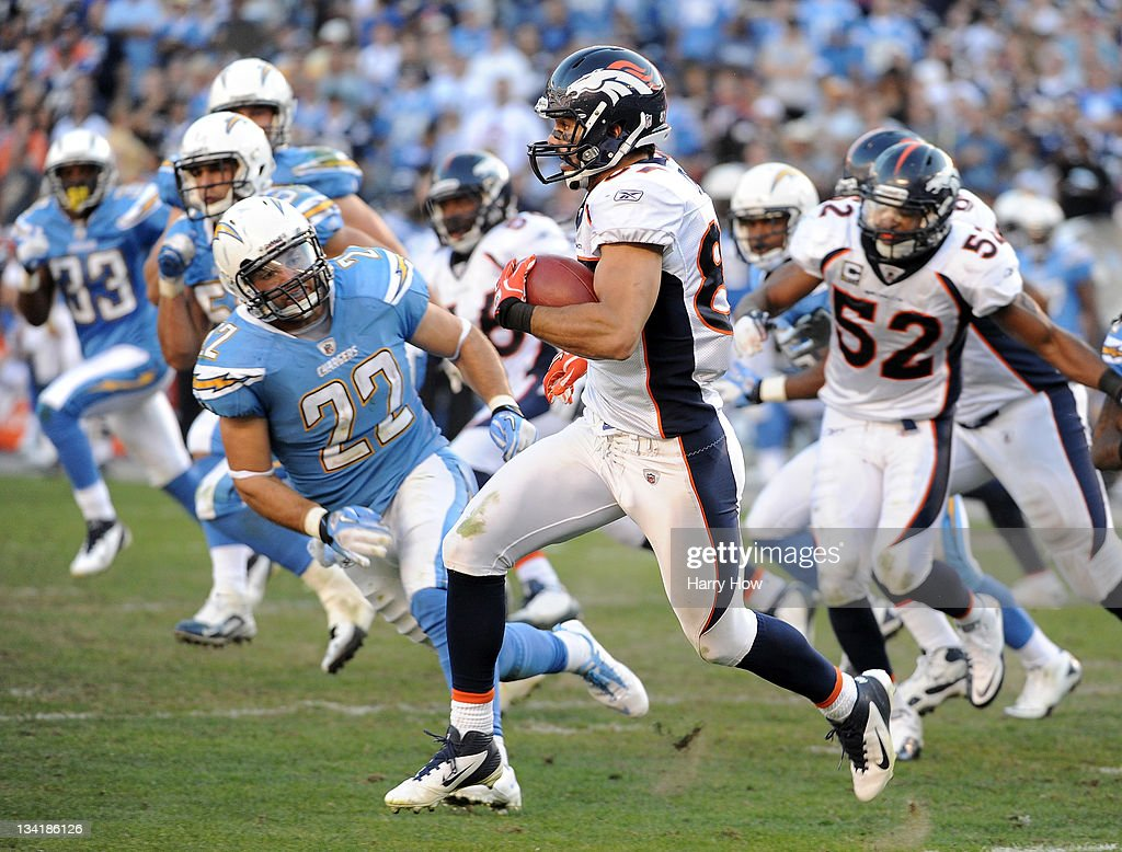 Eric Decker #87 of the Denver Broncos runs for yards after his catch in front of <a gi-track='captionPersonalityLinkClicked' href=/galleries/search?phrase=Jacob+Hester&family=editorial&specificpeople=2109848 ng-click='$event.stopPropagation()'>Jacob Hester</a> #22 of the San Diego Chargers at Qualcomm Stadium on November 27, 2011 in San Diego, California. The Broncos went on to win 16-13.