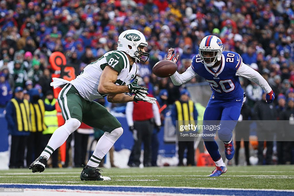 <a gi-track='captionPersonalityLinkClicked' href=/galleries/search?phrase=Eric+Decker&family=editorial&specificpeople=3950667 ng-click='$event.stopPropagation()'>Eric Decker</a> #87 of the New York Jets catches a touchdown pass in front of <a gi-track='captionPersonalityLinkClicked' href=/galleries/search?phrase=Corey+Graham&family=editorial&specificpeople=4294650 ng-click='$event.stopPropagation()'>Corey Graham</a> #20 of the Buffalo Bills during the second half at Ralph Wilson Stadium on January 3, 2016 in Orchard Park, New York.