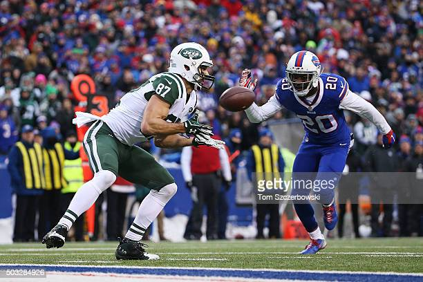 Eric Decker of the New York Jets catches a touchdown pass in front of Corey Graham of the Buffalo Bills during the second half at Ralph Wilson...