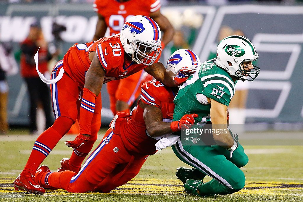 Eric Decker #87 of the New York Jets is tackled by Bacarri Rambo #30 and Nigel Bradham #53 of the Buffalo Bills during the third quarter at MetLife Stadium on November 12, 2015 in East Rutherford, New Jersey. The Buffalo Bills defeated the New York Jets 22-17.