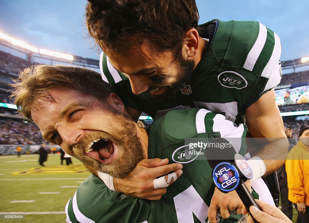 <a gi-track='captionPersonalityLinkClicked' href=/galleries/search?phrase=Eric+Decker&family=editorial&specificpeople=3950667 ng-click='$event.stopPropagation()'>Eric Decker</a> #87 of the New York Jets jumps on the back of <a gi-track='captionPersonalityLinkClicked' href=/galleries/search?phrase=Ryan+Fitzpatrick&family=editorial&specificpeople=622098 ng-click='$event.stopPropagation()'>Ryan Fitzpatrick</a> #14 of the New York Jets during a television interview after their 26-20 overtime win against the New England Patriots at MetLife Stadium on December 27, 2015 in East Rutherford, New Jersey.