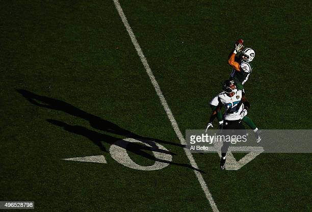 Eric Decker of the New York Jets makes a catch against Dwayne Gratz of the Jacksonville Jaguars during their game at MetLife Stadium on November 8...