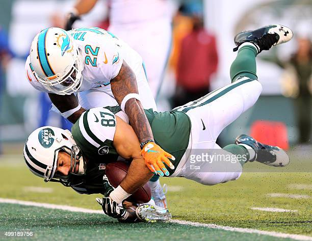 Eric Decker of the New York Jets makes the catch for the touchdown as Jamar Taylor of the Miami Dolphins defends on November 29 2015 at MetLife...