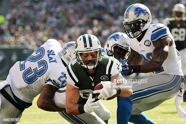 Eric Decker of the New York Jets scores a touchdown in the third quarter against the defense of Darius Slay of the Detroit Lions at MetLife Stadium...