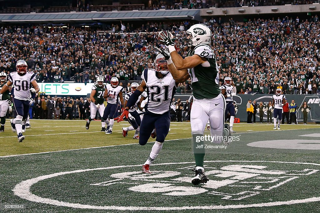 Eric Decker of the New York Jets scores the game winning touchdown in overtime against the New England Patriots in their game at MetLife Stadium on...